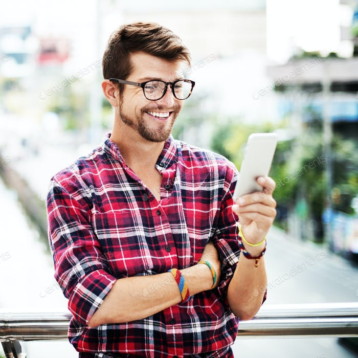 Young Man Outdoors Browsing Smartphone Concept