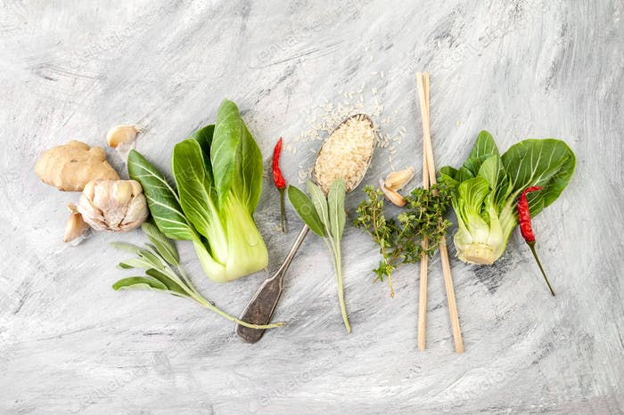 Salad Pak-choi (Chinese cabbage), rice and seasonings on a light