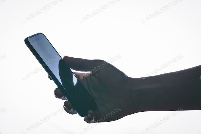 Close up. Smartphone in the hand with backlight and modern style