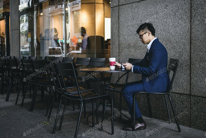 Asian businessman in a cafe