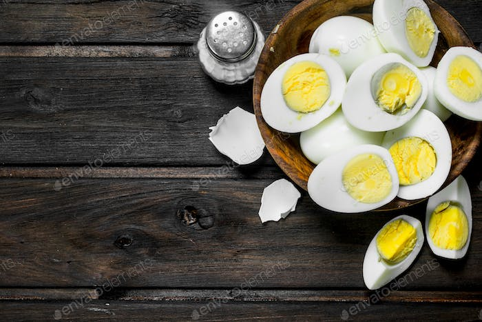 Boiled eggs in bowl with salt.