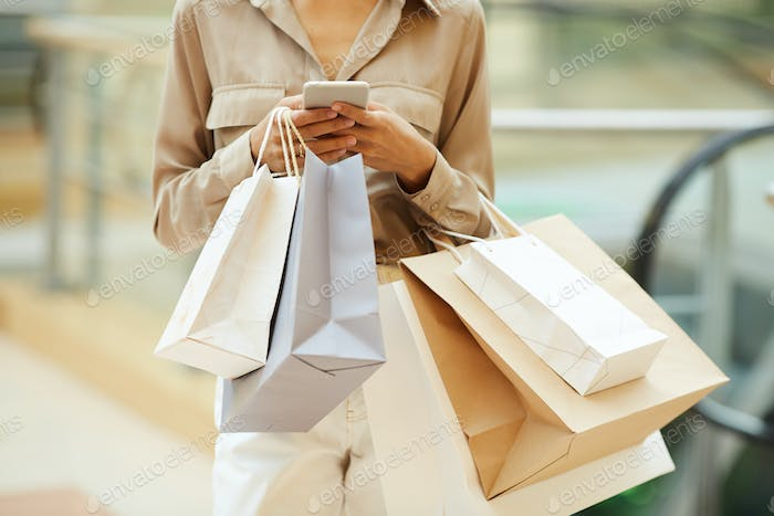 Woman with paper bags and phone