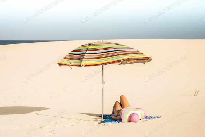 Beautiful beach and caucasian female lay down