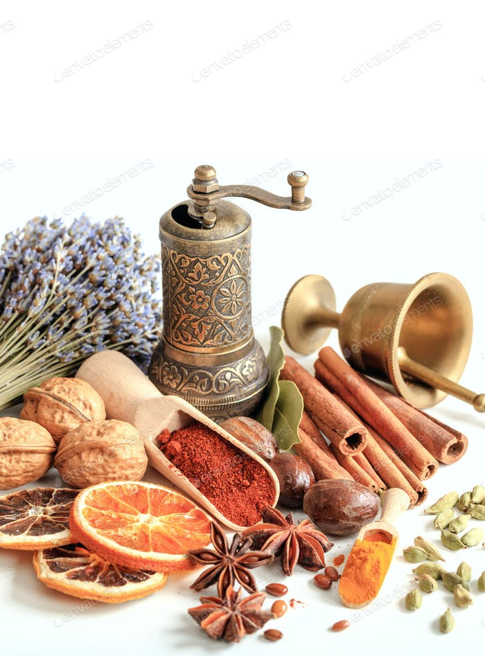 Spices and herbs with a lavender bunch on white background