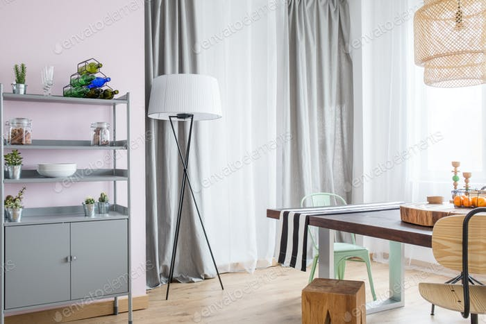 Room with grey window curtain