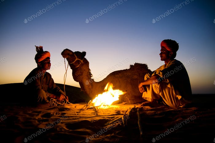 Two Indigenous Indian Men Resting By The Bon Fire With Their Cam