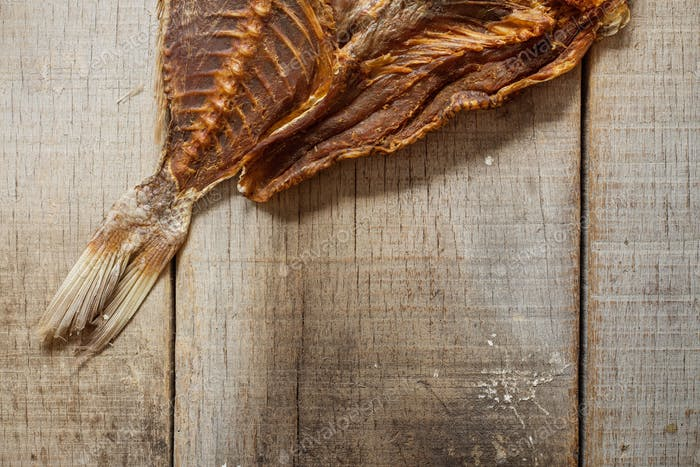 Dried fish on wooden