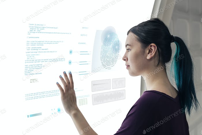 Girl coding on a interactive screen