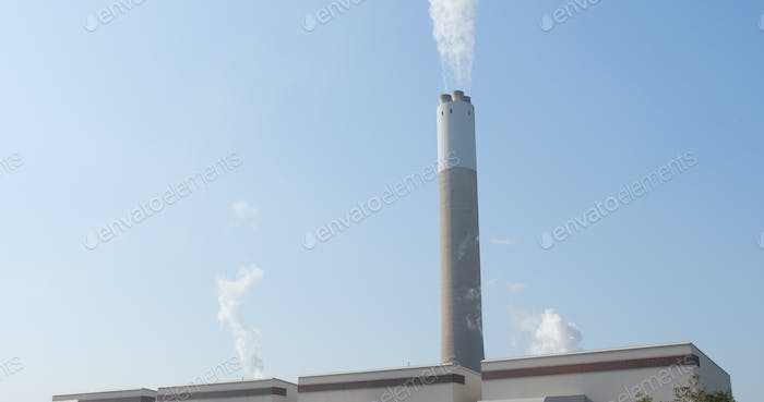 Smoke from chimney with blue sky