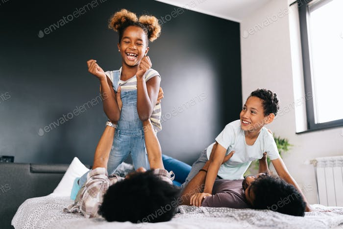 Happy african family enjoying spending time together at home