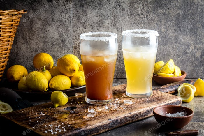 Two types of latin american beer drink Michelada with lemon juice and salt
