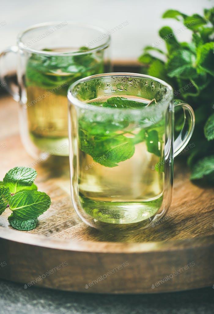 Hot herbal mint tea drink in glass mugs