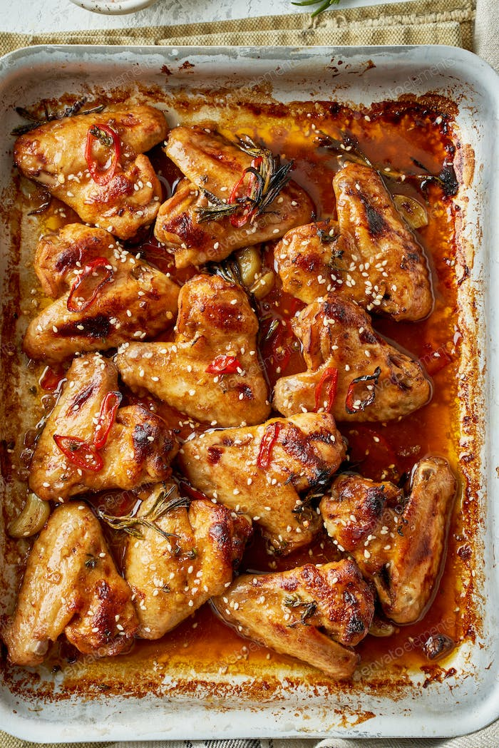 Barbecue chicken wings. Sticky asian spicy wings with teriyaki. ven baked marinated chiken