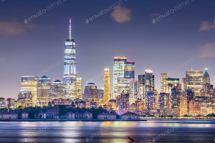 New York, New York, USA skyline from the harbor with Ellis Islan