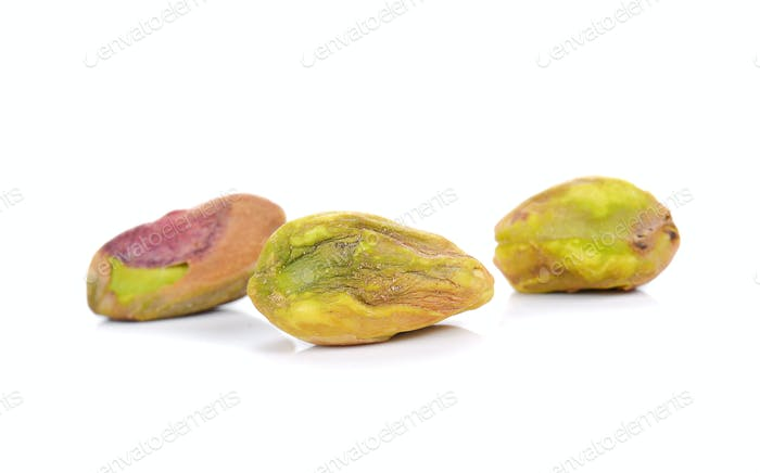 Pistachio nuts on white background.
