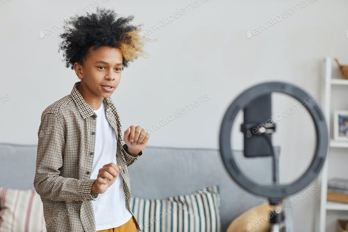 African-American Boy Recording Videoblog