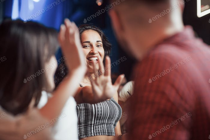 Hello there. Happy people have conversation in the luxury night club together