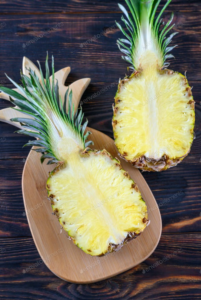 Pineapple on the wooden board