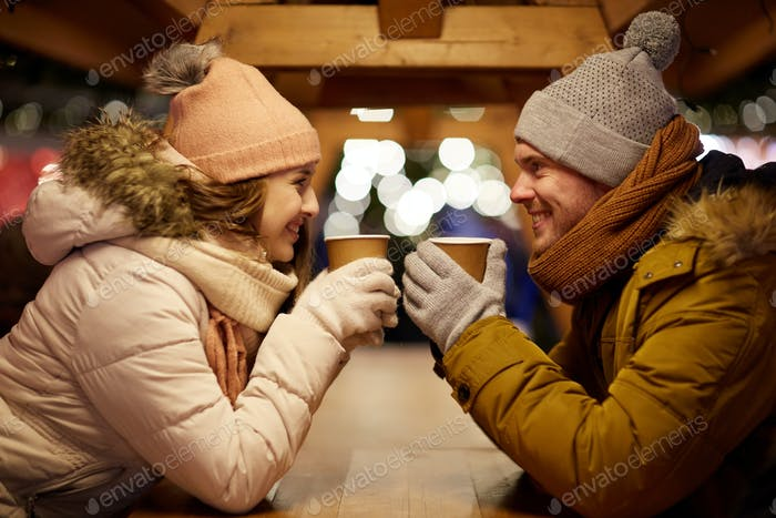 Thumbnail for happy young couple with coffee at christmas market
