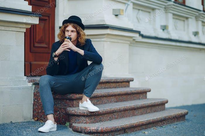 Thinking hipster man