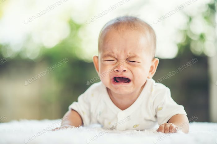Baby boy crying. Sad child portrait