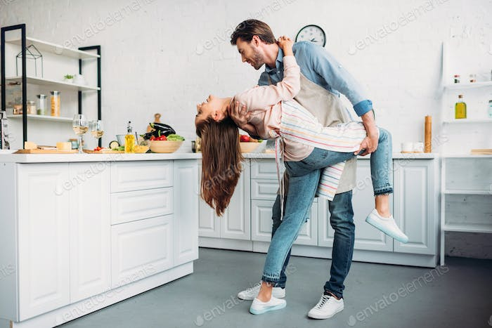couple dancing tango together in kitchen