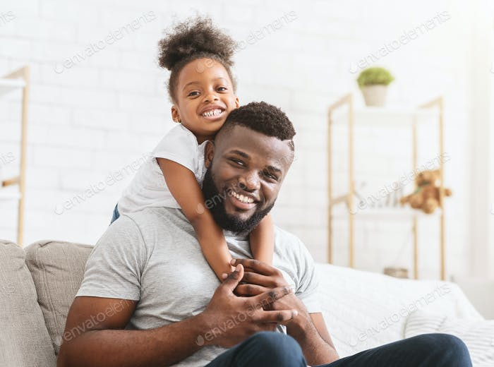 Beautiful afro family of two posing at home