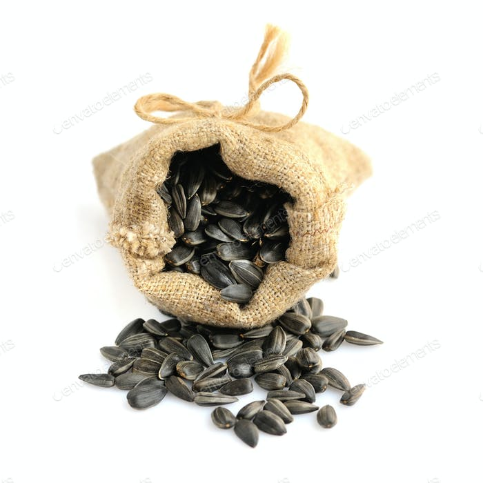 Sunflower seeds in a canvas bag isolated on white background, se