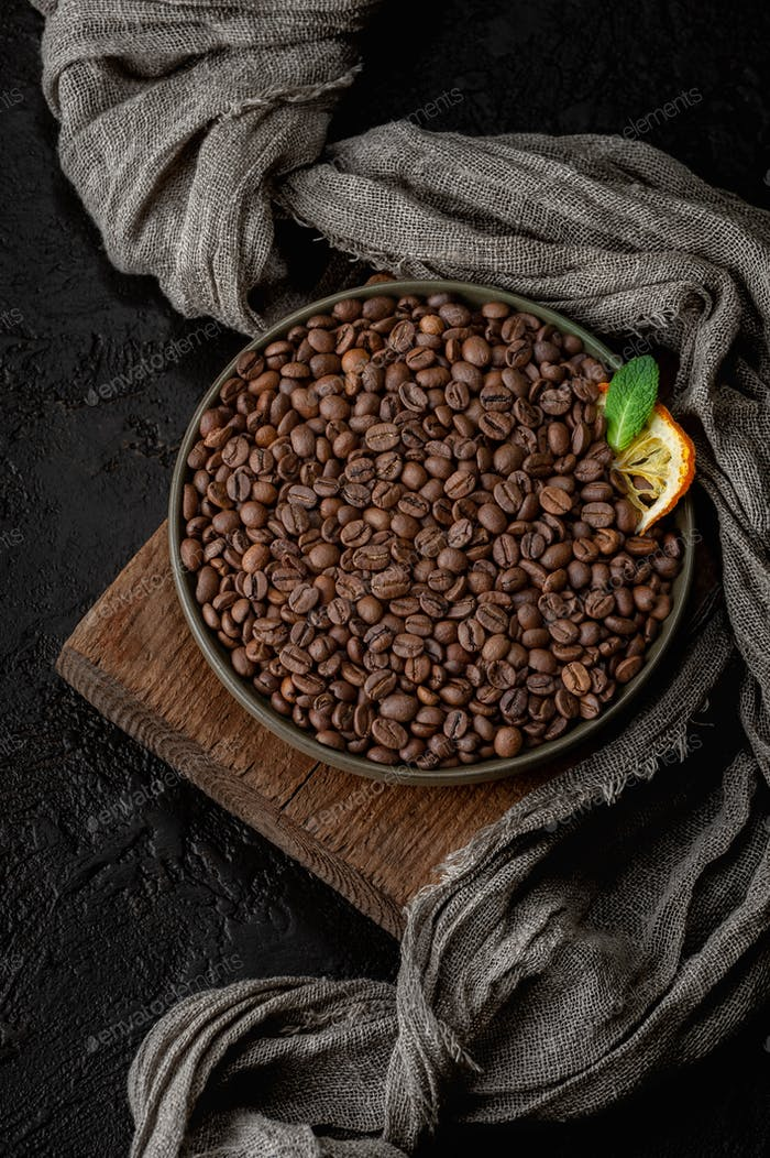 Roasted coffee beans on a dark background.
