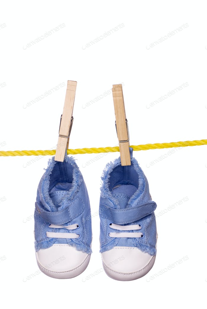 Baby shoes hanging on a clothesline