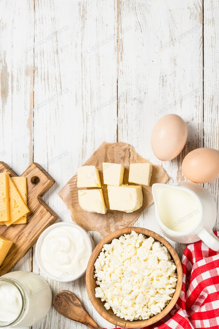 Dairy product at white wooden table