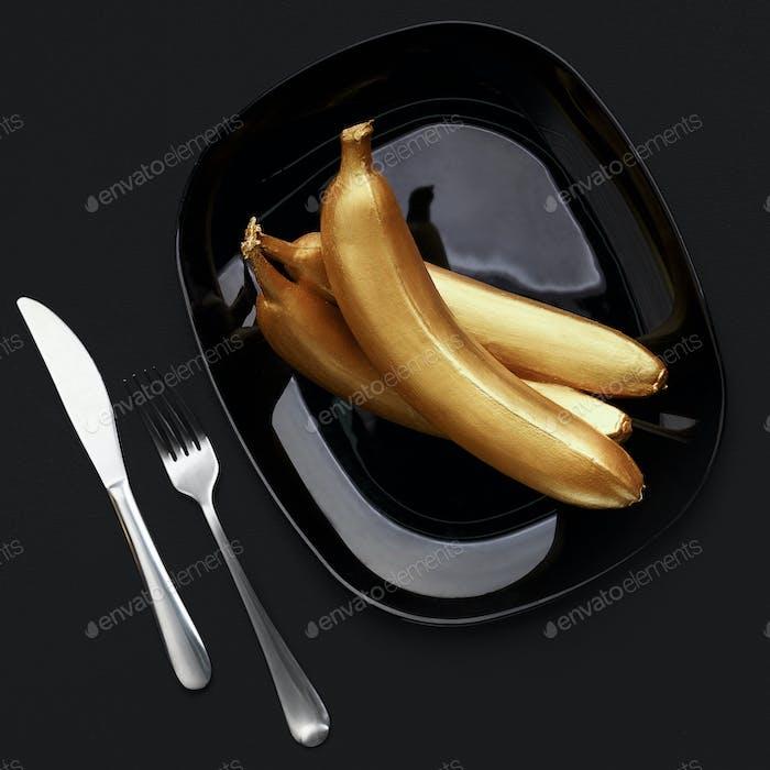 Golden bananas on plate