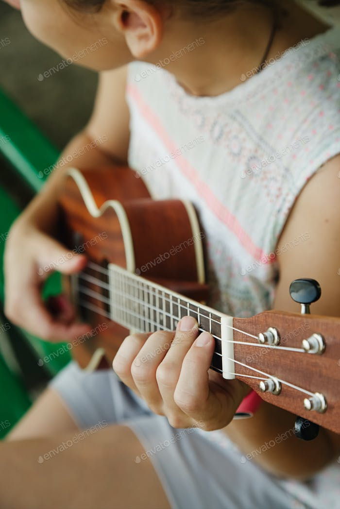 Anonymous woman playing ukulele