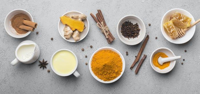 Frische Zutaten für Kurkuma Kurkuma gesundes Getränk auf grau