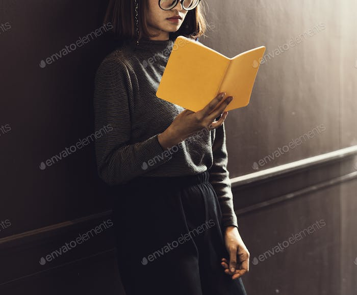 Girl with Glasses Standing Reading Book