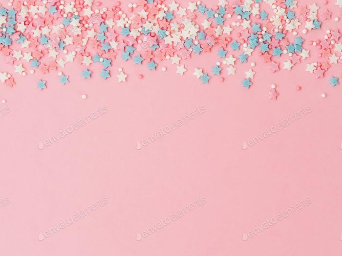 Sprinkles on pink, copy space bottom