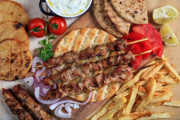 Grilled meat skewers on a pita bread - top view