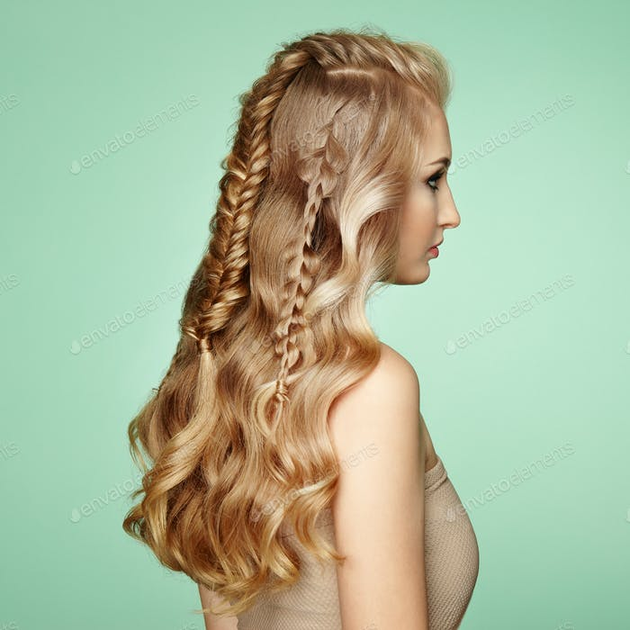 Blonde girl with long and shiny curly hair