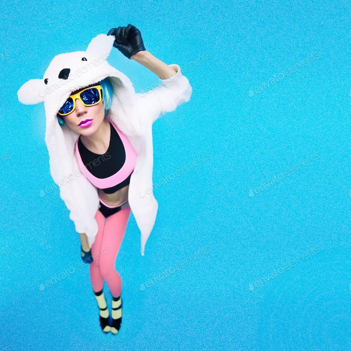 Funny party girl in hoodie bear on a blue background. Bright win