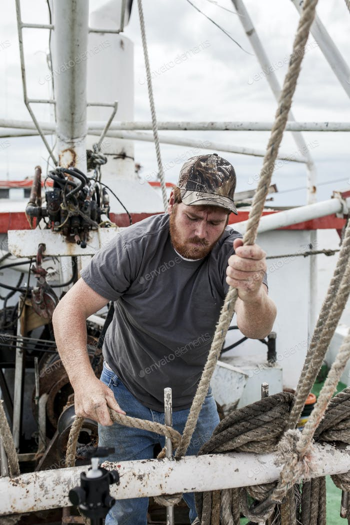Commercial fisherman working on the deck of a ship