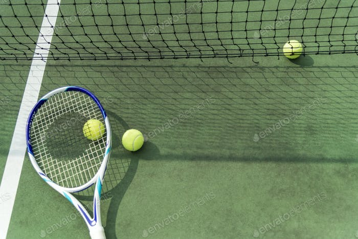 Tennis balls on a tennis court