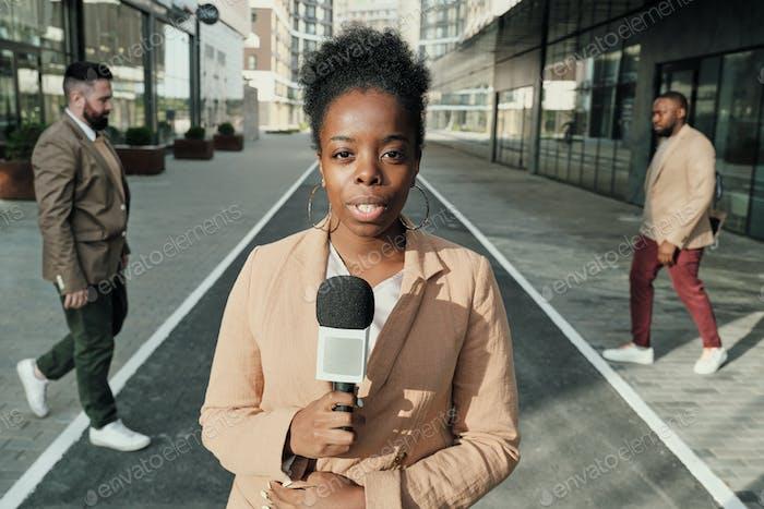 Female reporter in the city