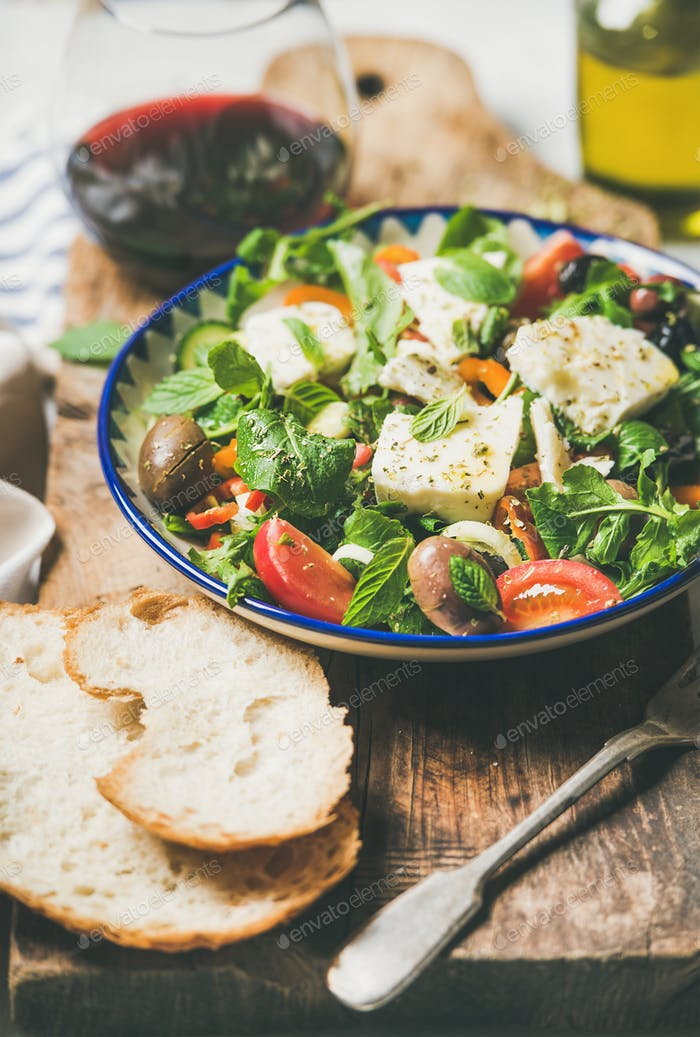 Traditional homemade Greek salad with feta cheese and olives, close-up