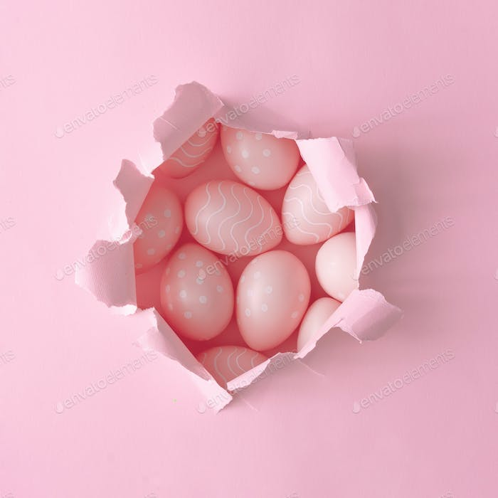 Pink Easter eggs with pink paper hole. Minimal Easter background composition. Flat lay.