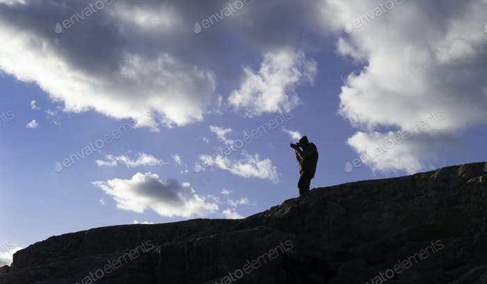Photographer on a Mountain