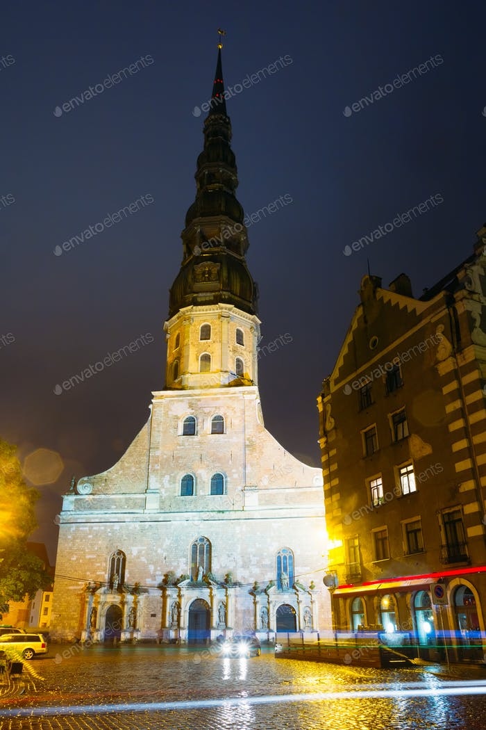 Riga Latvia. Night View Of Famous Landmark - St. Peter's Church
