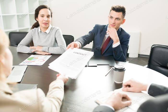 Business Manager Handing Contract to Client