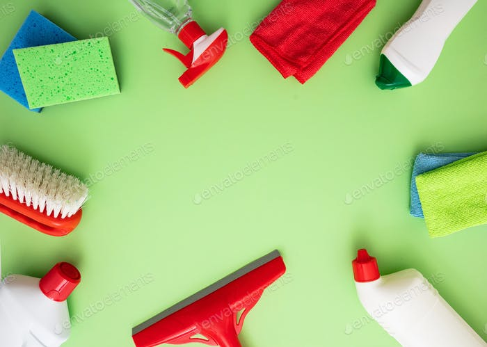 Cleaning products background, detergent bottles and tools, copy space