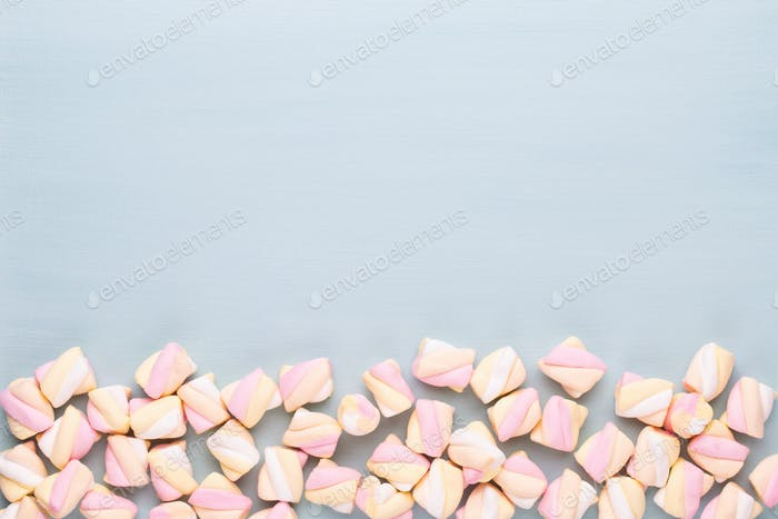 Colorful marshmallows background with copy space.