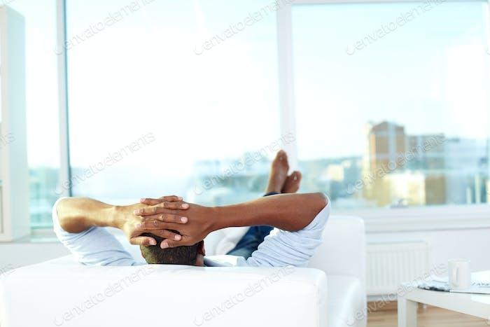 Resting on sofa